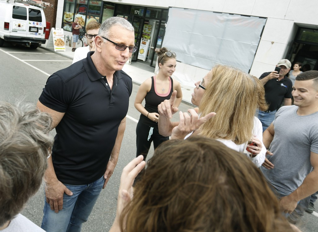 Robert Irvine, host of Restaurant Impossible, visits with fans outside of Uncle Andy's in South Portland on Tuesday.