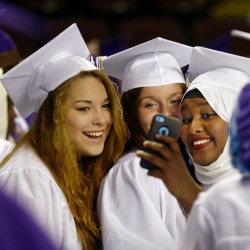 Left to to right, Sobrina McKeen, Danielle Turner and Ayni Shardi take a selfie prior to the Deering High School graduation at the Cumberland County Civic Center.