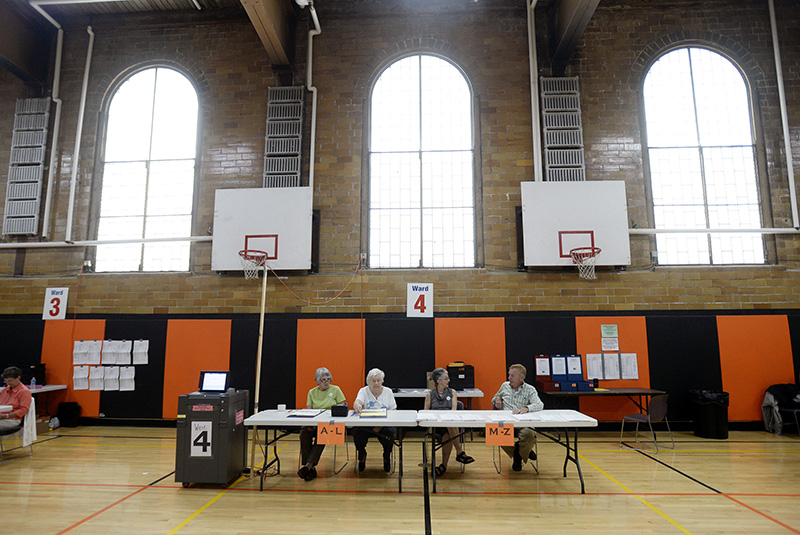 Left to right, ward clerk Anne Strout and ward workers Barbara Jackson, Ruth Boissonnault and Alfred Martel sit at their posts and wait for voters at the J. Richard Martin Community Center in Biddeford on Tuesday.