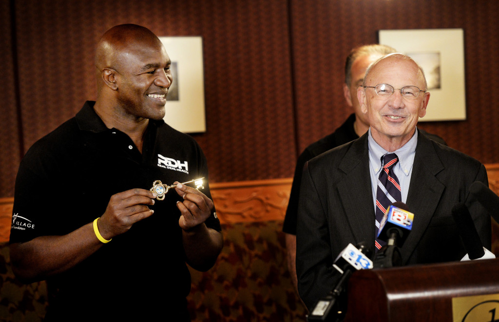 Former five-time heavyweight boxing champion Evander Holyfield shows off the key to the city after Portland Mayor Michael Brennan gave it to him during a ceremony at the Portland Regency Hotel and Spa on Friday,