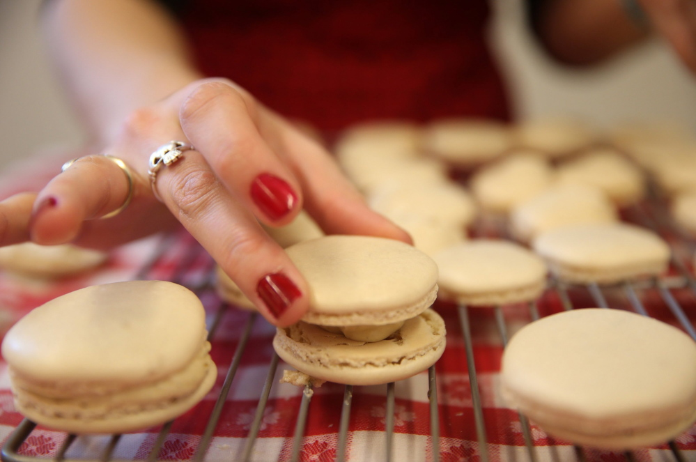 Heather Schroering finishes her macarons with a vanilla filling during class at the Alliance Francaise de Chicago.