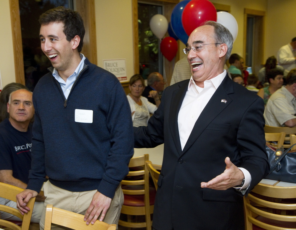 "Bruce Poliquin celebrates with his son Sam after winning the Republican nomination in Maine's 2nd Congressional District in 2014. The congressman said Thursday, ""My own son has an asthma condition, a pre-existing condition."" The bill that Poliquin voted for Thursday would undermine protections for people with pre-existing conditions, but exempt Congress and congressional staff members from such provisions."