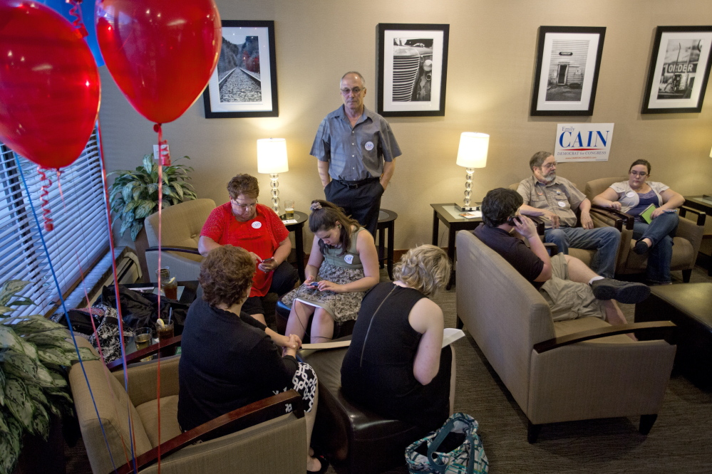 Members of Emily Cain's family wait in a room at the Holiday Inn on Odlin Road in Bangor for results from the primary election Tuesday.