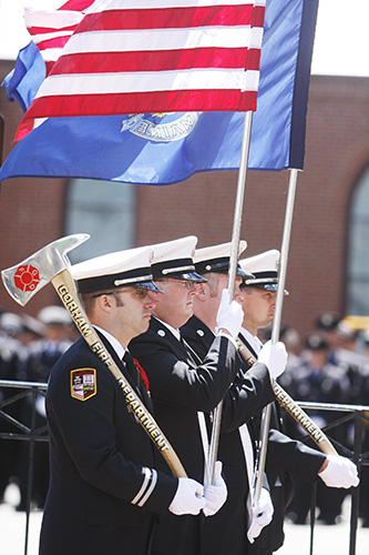 Members of the Gorham Fire Department color guard stand at attention following the funeral service for Portland Fire Capt. Michael Kucsma at the Cathedral of the Immaculate Conception in Portland Saturday,  Jill Brady/Staff Photographer