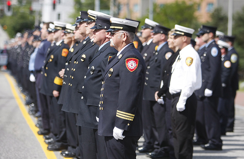Firefighters line Cumberland Avenue in Portland before the funeral service for Portland Fire Capt. Michael Kucsma at the Cathedral of the Immaculate Conception Saturday. Jill Brady/Staff Photographer