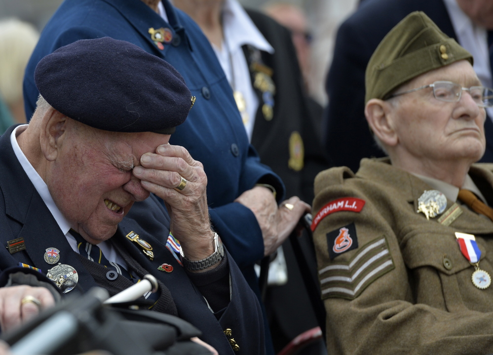 A British D-Day veteran reacts during a commemoration ceremony and parade by the British Army 3rd Division at Hermanville-sur-Mer on the Normandy coast Thursday. Reuters