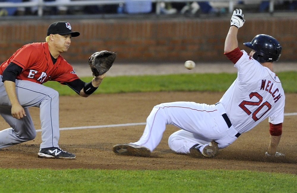 Stefan Welch of the Portland Sea Dogs slides safely into third base with a triple as Corey Jones of the Erie SeaWolves waits for the ball Thursday night at Hadlock Field. Welch tripled twice in a 5-3 victory. Gordon Chibroski/Staff Photographer