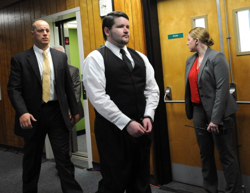 "Seth Mazzaglia is escorted into the courtroom at Strafford County Superior Court in Dover, N.H., on Friday. He is charged with first-degree murder in the October 2012 slaying of 19-year-old Elizabeth ""Lizzi"" Marriott of Westborough, Mass.  The Associated Press"