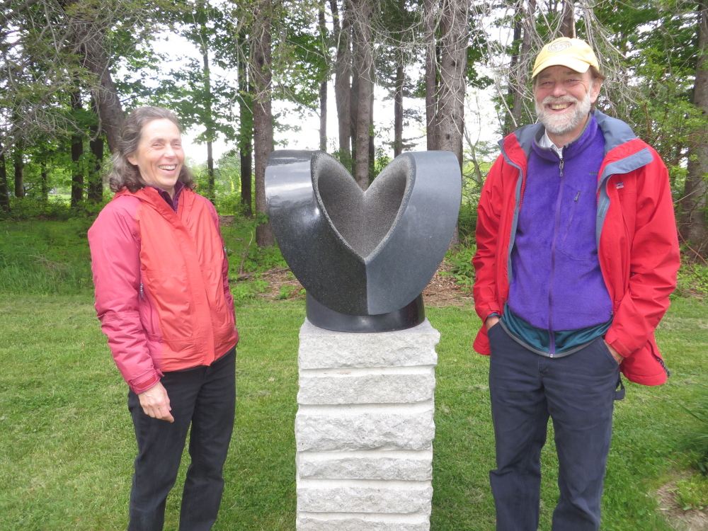 "Lucy Hull and Bart Chapin of Arrowsic at Gilsland Farm, beside ""Euphoria"" by their son Miles Chapin, a stone sculptor who lives in Vermont."