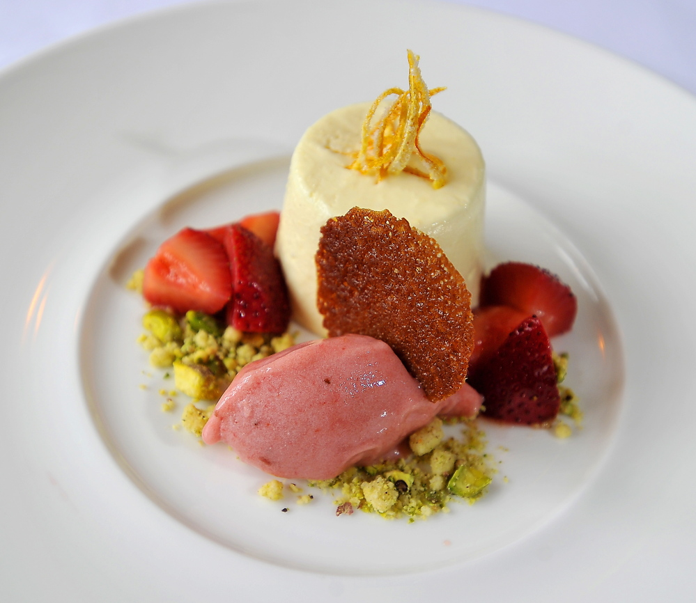 Ginger Bavarian mousse with strawberries, pistachio cookie crumble and rhubarb sorbet. Gordon Chibroski/Staff Photographer