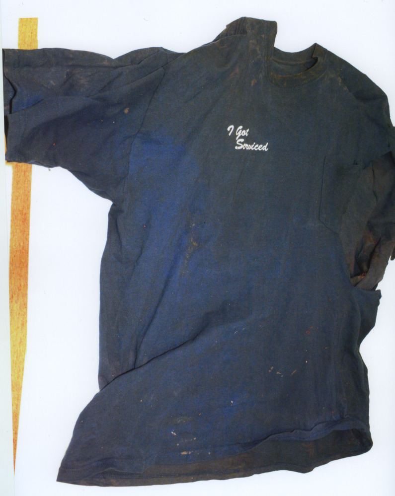 This photo released by the Cape and Islands District Attorney's office on Friday June 6, 2014 shows the shirt that was on a mutilated body found Wednesday, June 4, 2014 at Town Neck Beach in Sandwich, Mass. On Friday, authorities appealed for public help to identify the decapitated, limbless torso of a man found wrapped in a tarp.