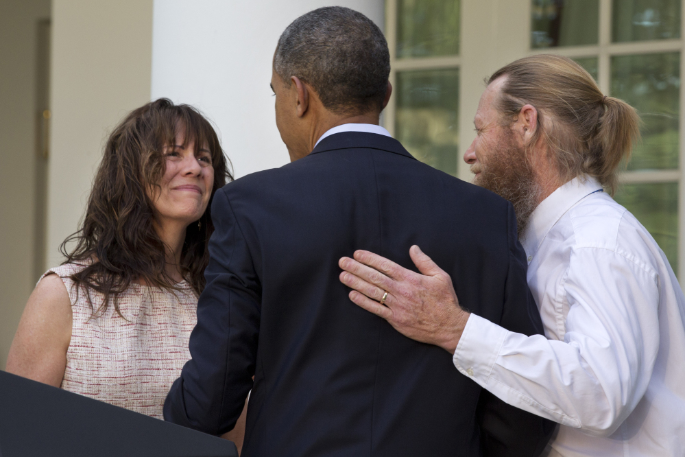 The Assoicated Press File Photo This May 31, 2014 file photo shows the parents of U.S. Army Sgt. Bowe Bergdahl, Jani Bergdahl, left, and Bob Bergdahl, turn to President Barack Obama after he spoke in the Rose Garden of the White House. Just a week after the president announced that Sgt. Bowe Bergdahl had been freed in Afghanistan, details emerging about the soldier, the deal and how the rescue came together have become a source of controversy.