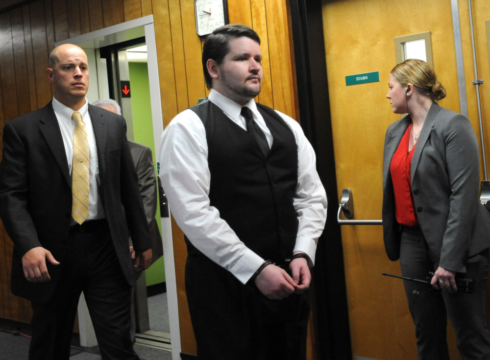 "Seth Mazzaglia of Dover, N.H., is escorted into the courtroom at Strafford County Superior Court in Dover on Friday, He is charged with first-degree murder in the death of 19-year-old Elizabeth ""Lizzi"" Marriott of Westborough, Mass. The Associated Press"