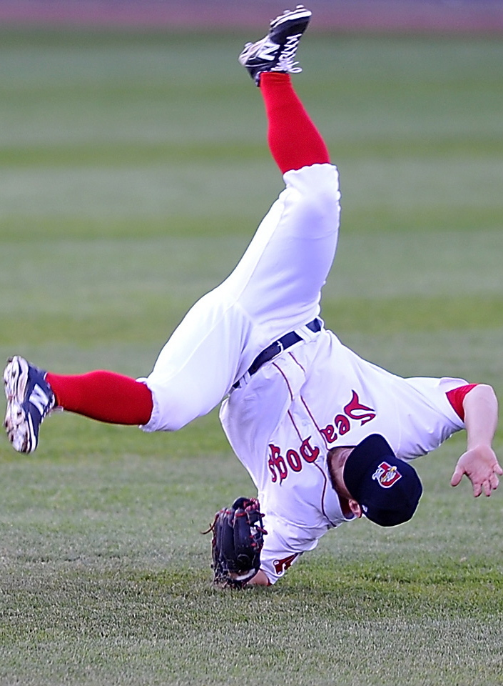 Second baseman Sean Coyle of the Portland Sea Dogs cartwheels across the field Friday night after making a diving catch against the Bowie Baysox at Hadlock Field. The Sea Dogs failed to come up with clutch hits and suffered a 6-4 setback. Gordon Chibroski/Staff photographer
