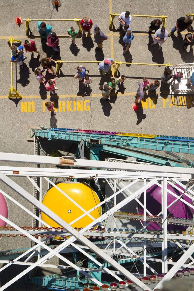 People wait to ride the Ferris wheel near Commercial Street during the Old Port Festival in Portland on Saturday. Carl D. Walsh / Staff Photographer
