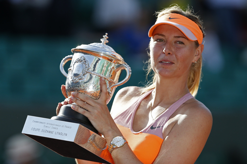 The Associated Press Russia's Maria Sharapova holds the trophy  after winning the final of the French Open tennis tournament against Romania's Simona Halep at the Roland Garros stadium, in Paris, France, Saturday.