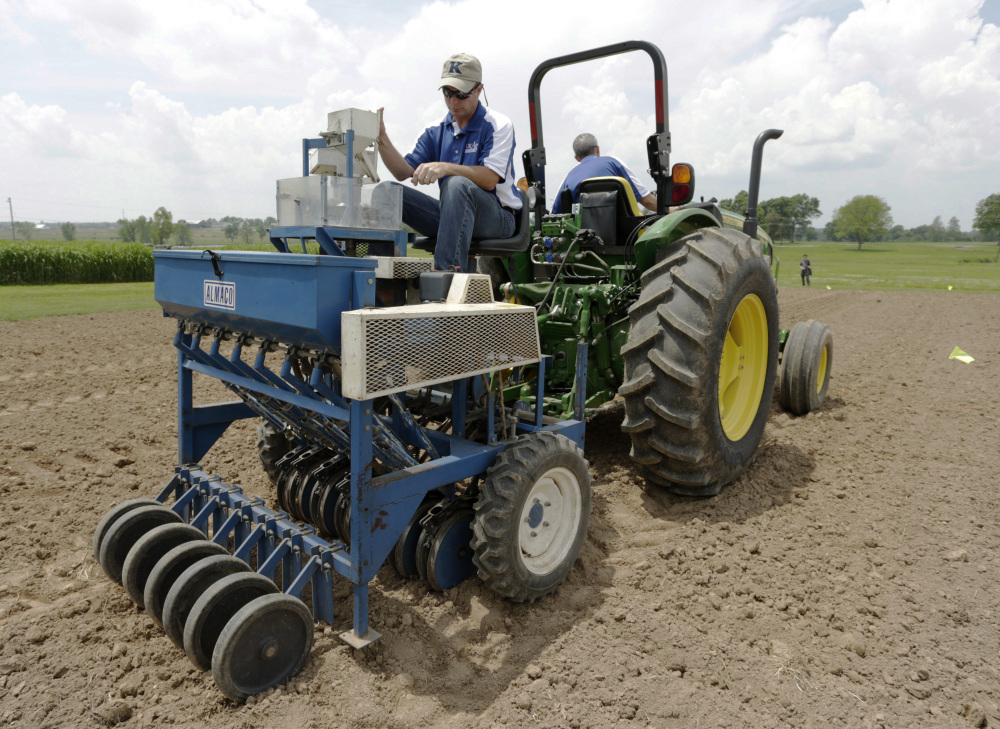 Richard Mundell sits on a plot seeder pulled by a tractor driven by Mark Sizemore, as they plant hemp seeds at the UK Spindletop Research Farm off of Newtown Pike in Lexington, Ky., on Tuesday, May 27, 2014. The Associated Press/The Lexington Herald-Leader, Pablo Alcala