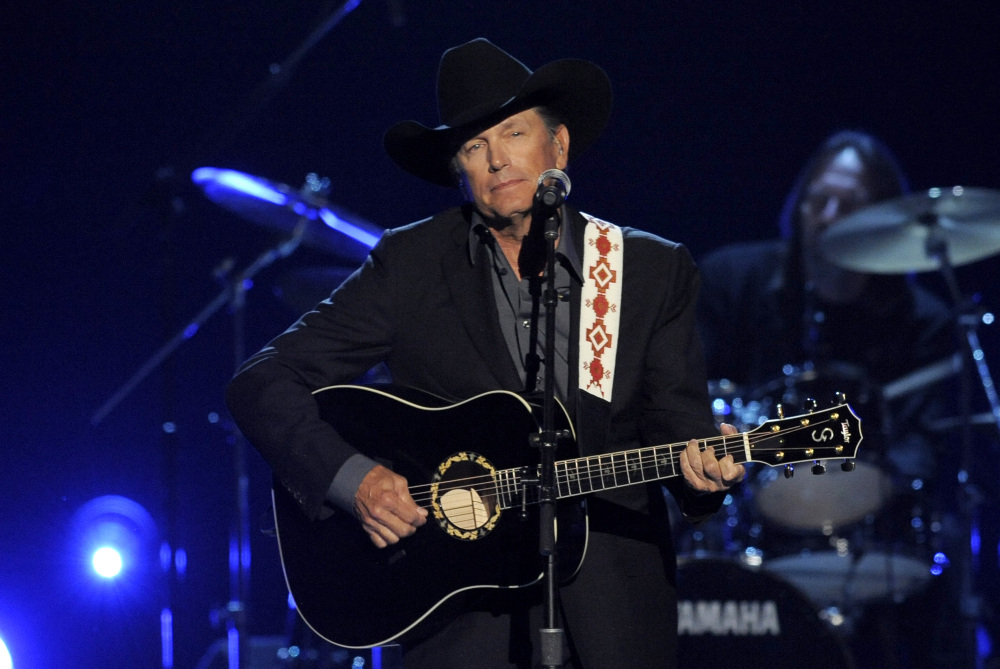 The Associated Press/Invision/Chris Pizzello This April 7, 2013 file photo shows George Strait performing at the 48th Annual Academy of Country Music Awards at the MGM Grand Garden Arena in Las Vegas. It's the end of the trail for country music king George Strait, who will wrap up his final tour Saturday, June 7, with a star-filled show at the lavish home of the Dallas Cowboys in his home state of Texas.