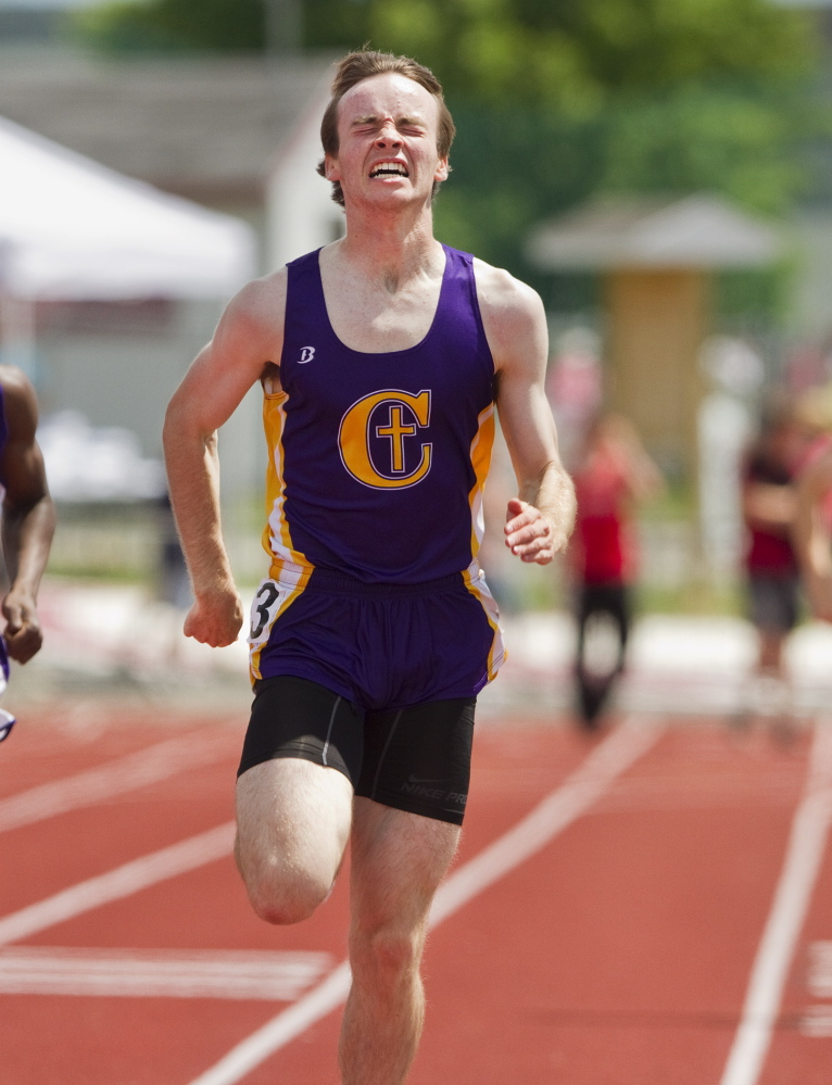 Jake Dixon heads toward the finish line to win the 400 meters Saturday at the Class A track and field state championships, helping Cheverus win the team title. Carl D. Walsh/Staff Photographer