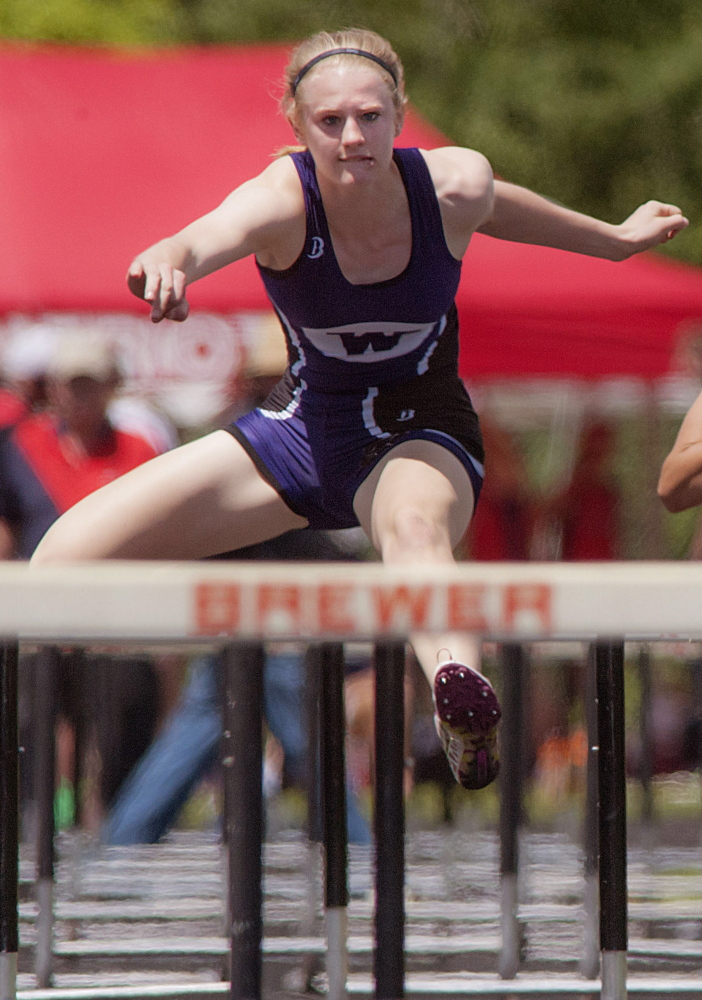 Sarah Shoulta of Waterville clears a hurdle on the way to victory Saturday in the 100-meter hurdles. Michael C. York/Special to the Telegram