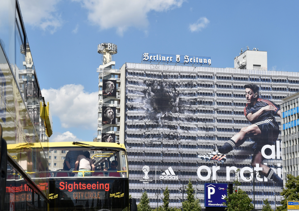 The Associated Press Sportswear manufacturer Adidas has put up an advertisement on the entire facade of a building in Berlin before the World Cup. The company has concerns over FIFA corruption claims.