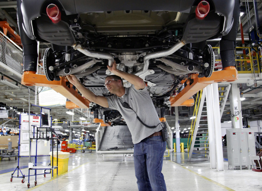 Jeff Caldwell, 29, a chassis assembly line supervisor, checks a vehicle on the assembly line at the Chrysler Jefferson North Assembly plant in Detroit. The U.S. economy finally regained the jobs lost during the Great Recession, but the comeback is far from complete. The Associated Press