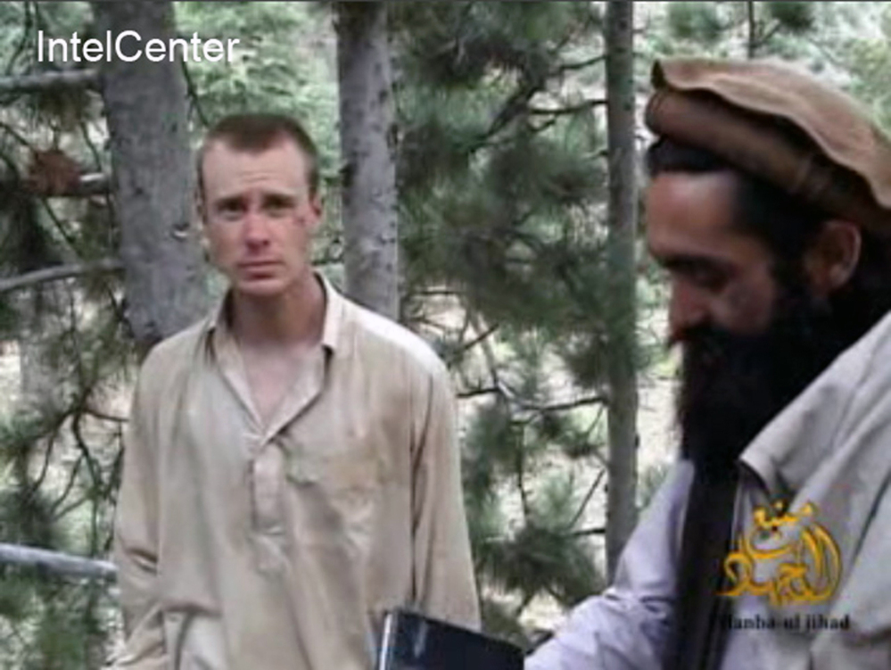 This file image made from video released by the Taliban and obtained by IntelCenter on Dec. 8, 2010, shows a man believed to be Bowe Bergdahl at left. The Associated Press