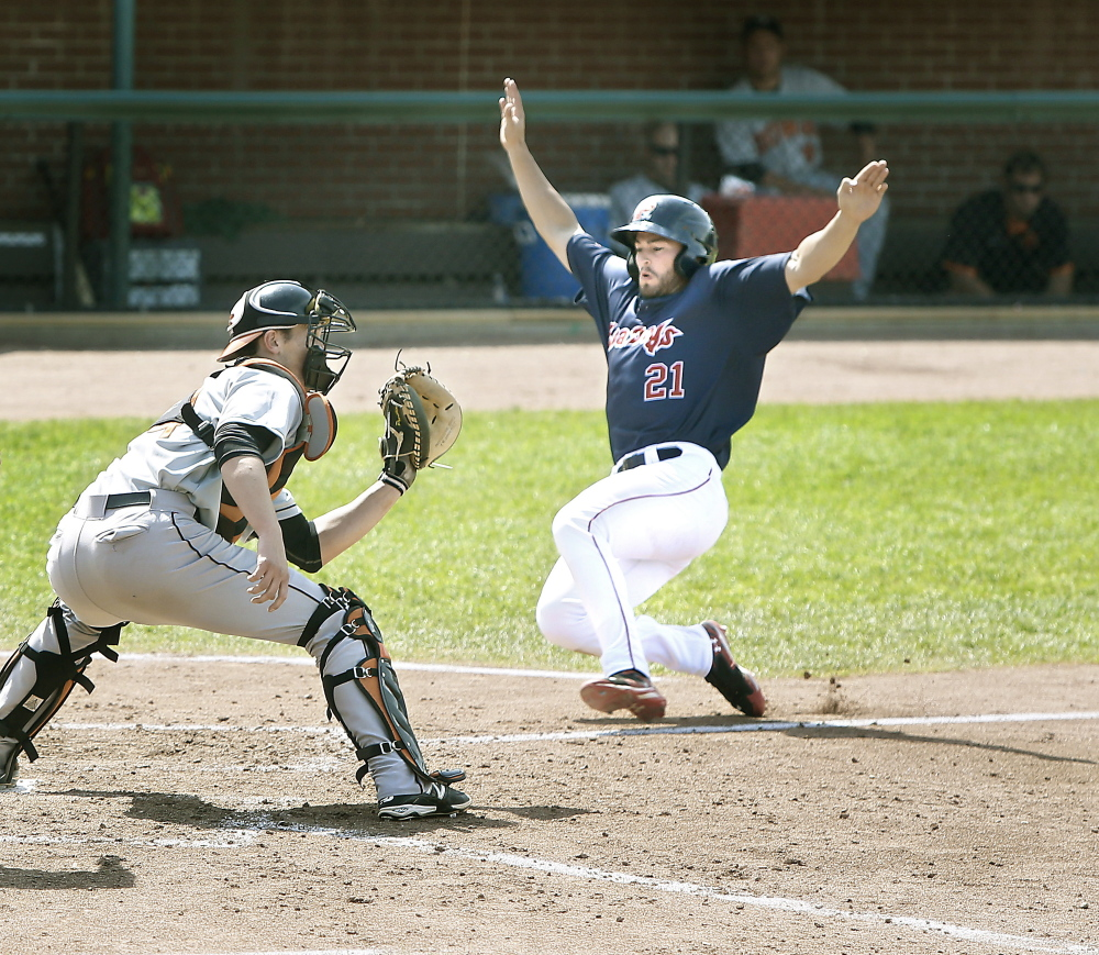 Bo Greenwell of the Portland Sea Dogs slides into home before Bowie Baysox catcher Michael Ohlman can apply the tag at Hadlock Field in Portland on Sunday. Tim Greenway/Staff Photographer