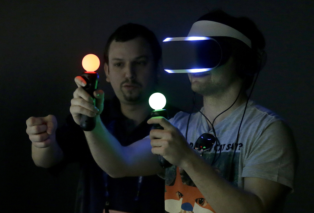 The Associated Press In this March 19, 2014 file photo, Marcus Ingvarsson, right, tests out the PlayStation 4 virtual reality headset Project Morpheus in a demo area at the Game Developers Conference 2014 in San Francisco.