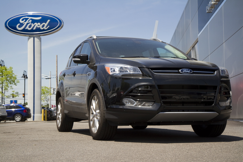 One of twelve vehicle stolen by a scam artist from area dealerships in late May, a 2014 Ford Escape is back at Rowe Ford in Westbrook where it was stolen from. Carl D. Walsh/Staff Photographer