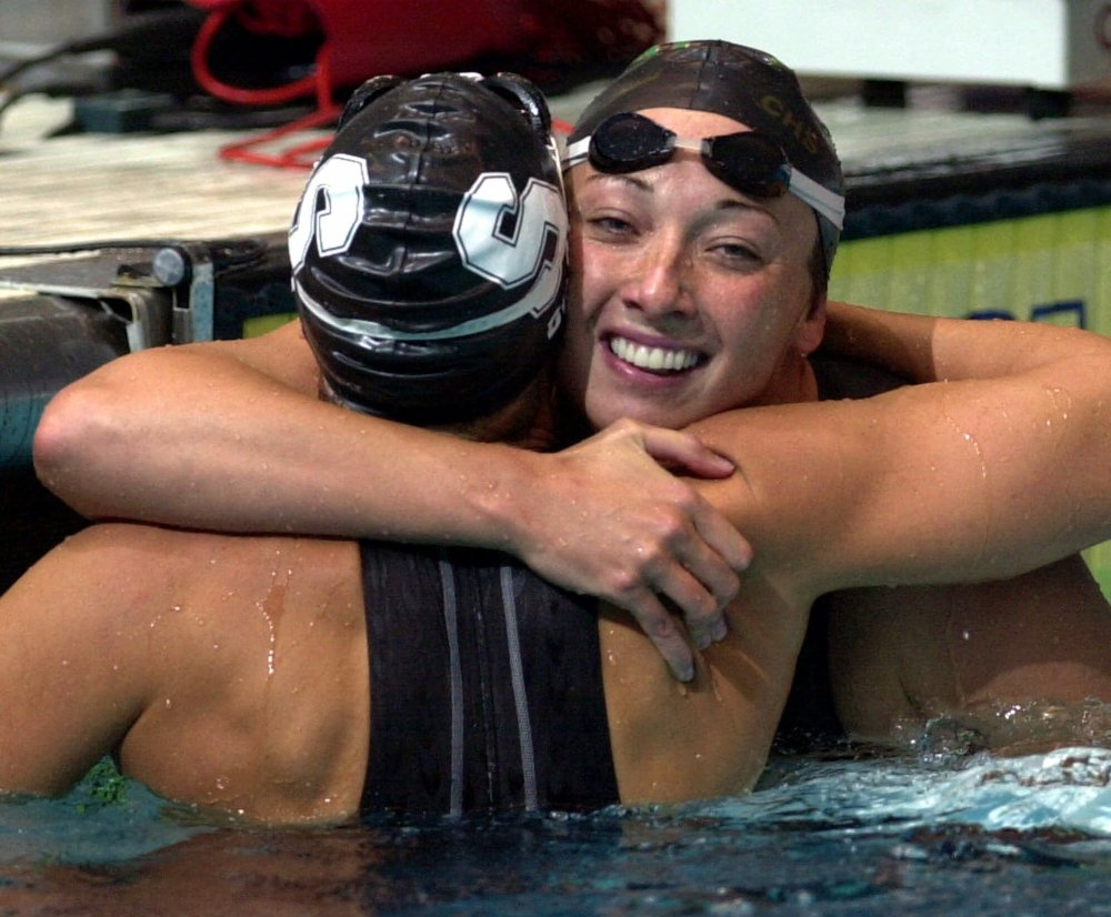 In this Aug. 16, 2000 file photo, Amy Van Dyken, right, of Lone Tree, Colo., hugs Dara Torres of Palo Alto, Calif., after Torres won the finals of the women's 50-meter freestyle at the U.S. Olympic Swimming Trials in Indianapolis. The Associated Press/Chris O'Meara