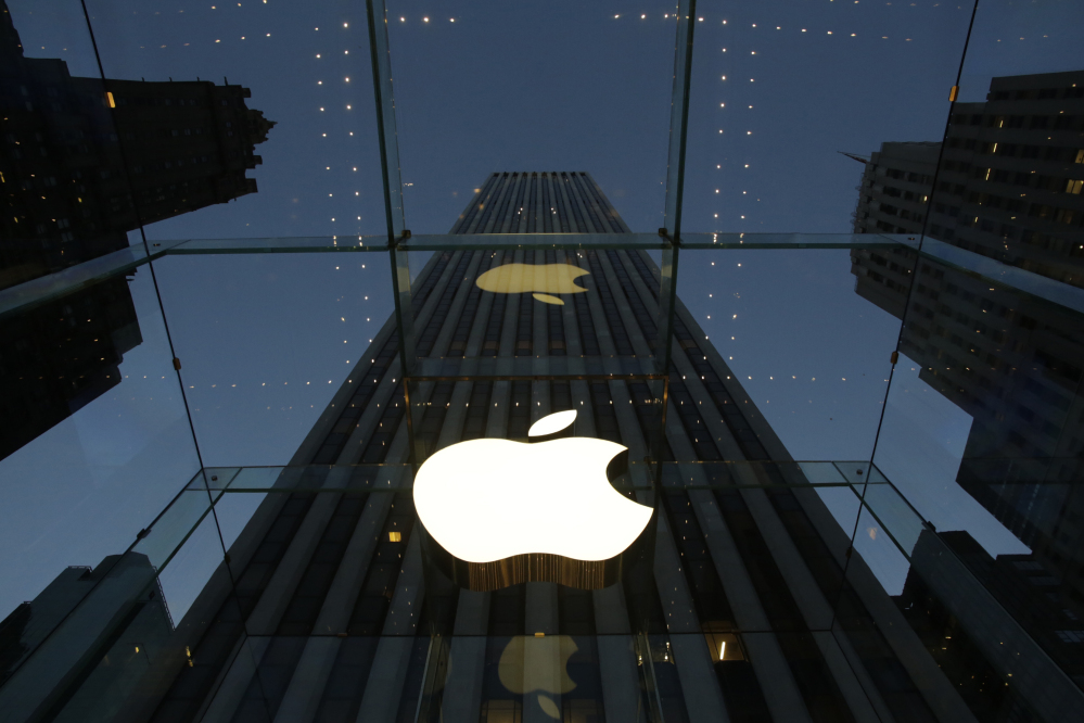 The Associated Press file photo The Apple logo is illuminated in the entrance to the Fifth Avenue Apple store in New York in this 2013 file photo. Six weeks ago, the iPhone and iPad maker announced plans to split its stock for the first time in nine years. Since then, Apple's shares have surged more than 20 percent. The stock split helped renew investor interest in Apple Inc., already the world's most valuable company.