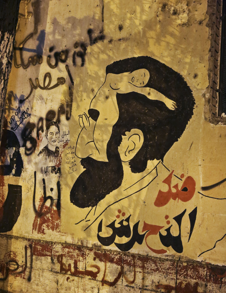 Anti-sexual harassment graffiti sits on a wall near Tahrir Square in Cairo. Egyptian police on Monday arrested seven men for sexually assaulting a 19-year-old student. The Associated Press