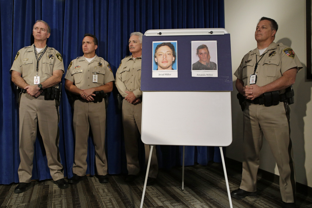 Pictures of suspects Jerad Miller and Amanda Miller are on display during a news conference, Monday in Las Vegas. The Associated Press