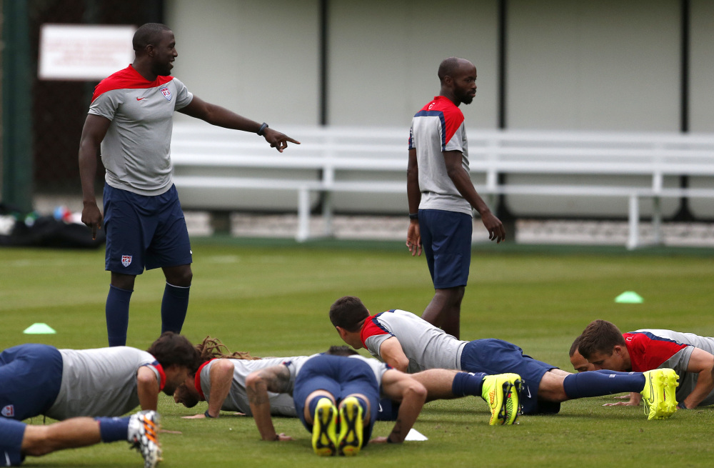 United States' Jozy Altidore, top left, gestures to teammate DaMarcus Beasley as teammates do push-ups during a training session at the Sao Paulo FC training center in Sao Paulo, Brazil, on Monday.