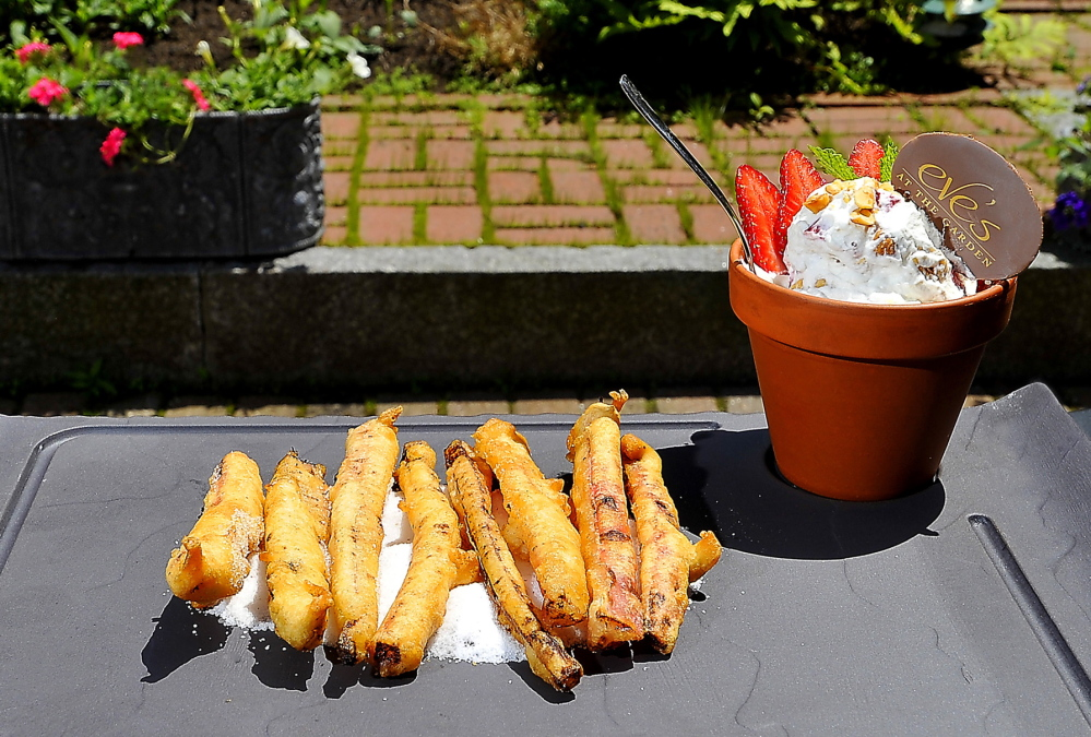 Eve's at the Garden chef Tim Labonte serves battered, deep-fried rhubarb stalks on flavored sugar granules with flavored whipped cream, strawberry slices and mint garnish.Gordon Chibroski/Staff Photographer
