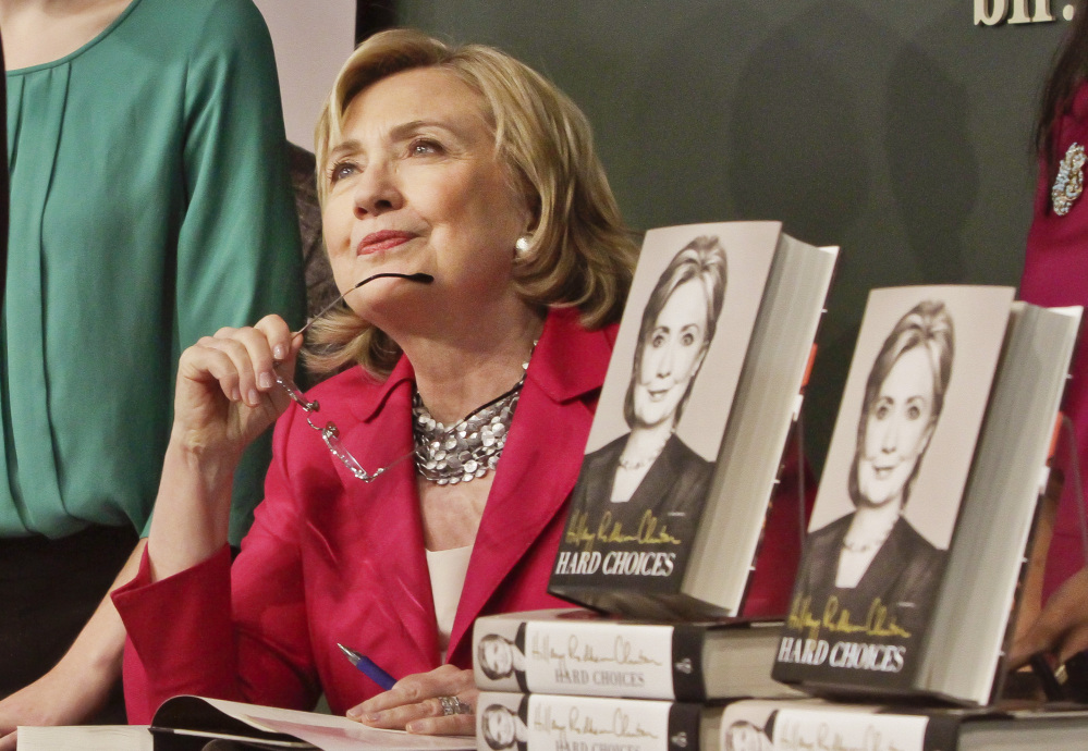 "HiIlary Rodham Clinton listens to a supporter as she signs a copy of her new book, ""Hard Choices,"" on Tuesday at the Barnes and Noble bookstore in New York. The Associated Press"