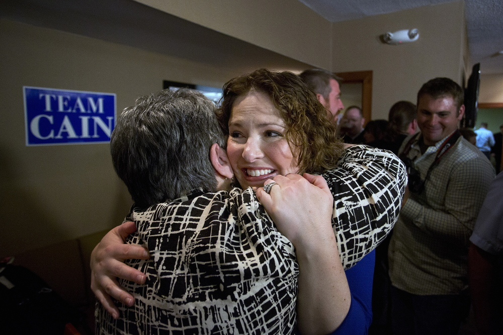 Emily Cain, Democratic victor in the 2nd Congressional District primary, hugs a supporter at the Holiday Inn in Bangor after she defeated her opponent, Troy Jackson. Gabe Souza/Staff Photographer