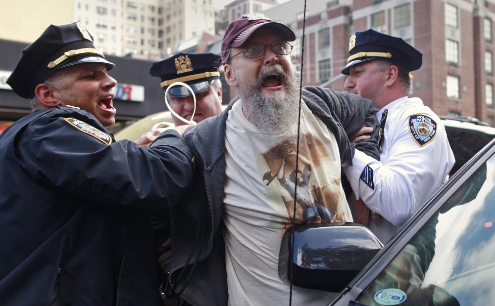 An Occupy Wall Street activist is arrested by New York City police during a May 1, 2012, demonstration. Reuters