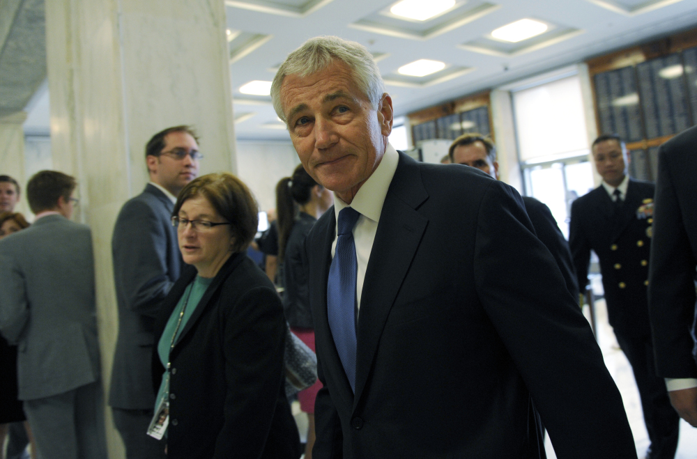 Defense Secretary Chuck Hagel arrives on Capitol Hill in Washington, Wednesday, to testify before the House Armed Services Committee. The Associated Press