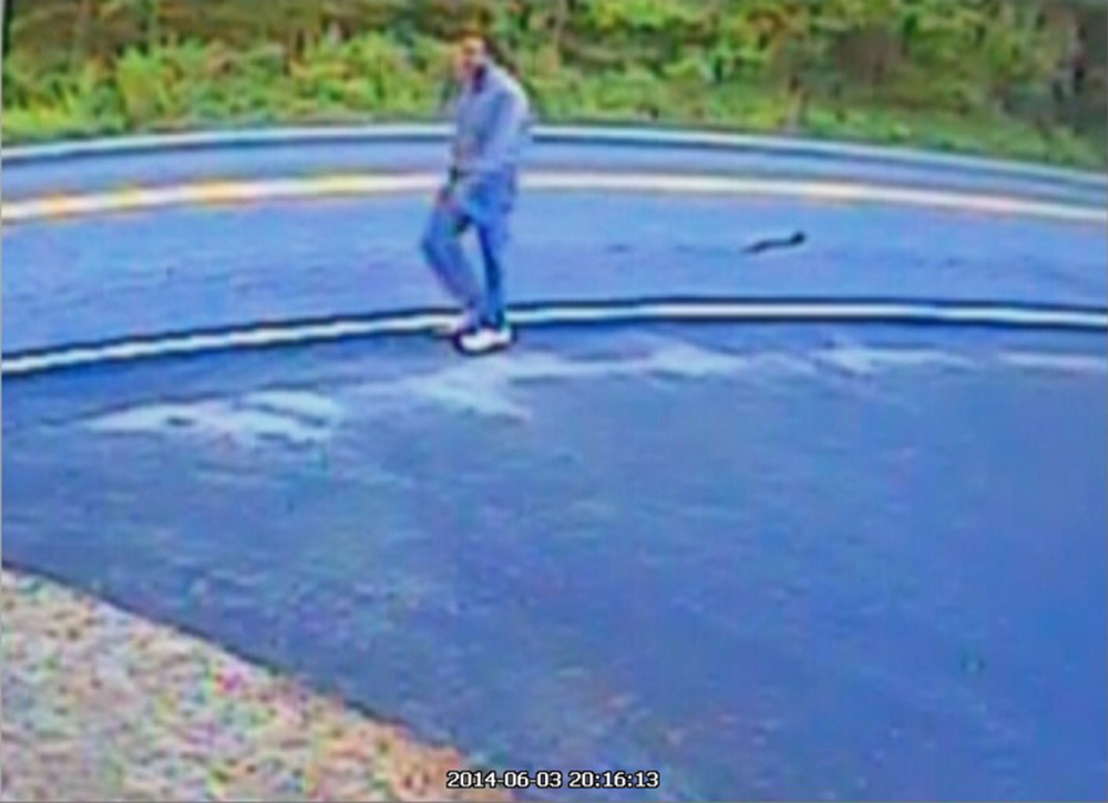 A homeowner's surveillance image allegedly shows suspect Robert C. Simkowitz. Police believe he picked the mailboxes he left notes in at random.
