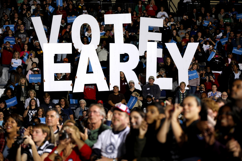 "In this Oct. 29, 2012 file photo a ""Vote Early"" sign is held up by supporters at a rally for President Barack Obama in Youngstown, Ohio. In key swing states this year, Democrats who want to expand early voting and Republicans who want to limit it, are battling to gain even the slightest electoral advantages by tinkering with the times, dates and places where people can vote early. Ohio's Republican-controlled legislature has taken recent steps, which are being challenged by both the American Civil Liberties Union and the U.S. Justice Department, to curtail early voting on weekends."