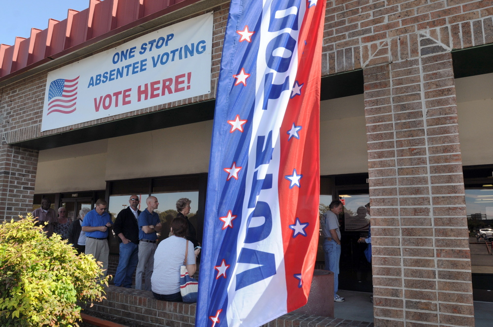 In this Oct. 22, 2012 file photo residents line up to vote early in Wilmington, N.C.