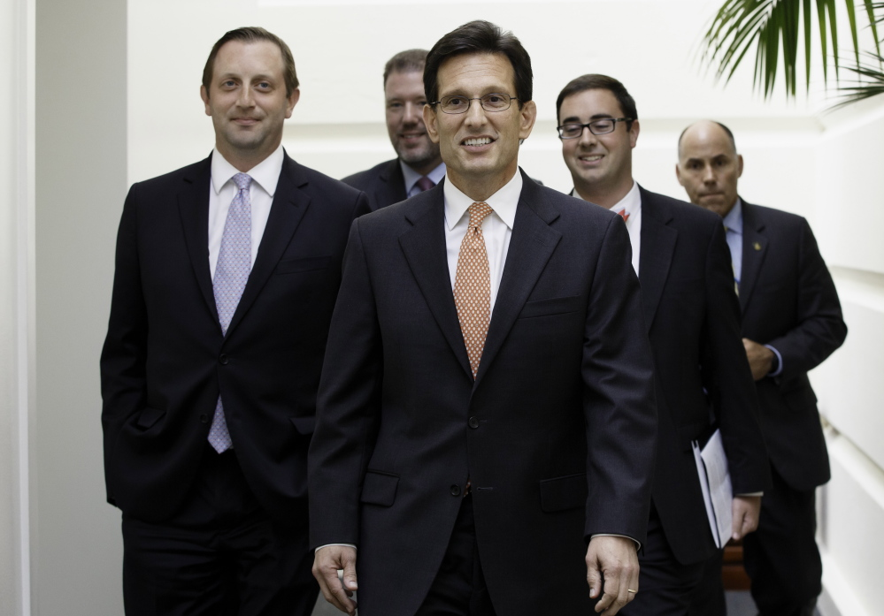 House Majority Leader Eric Cantor arrives on Capitol Hill in Washington on Wednesday,  the day after his defeat in the Virginia primary by tea party challenger David Brat.
