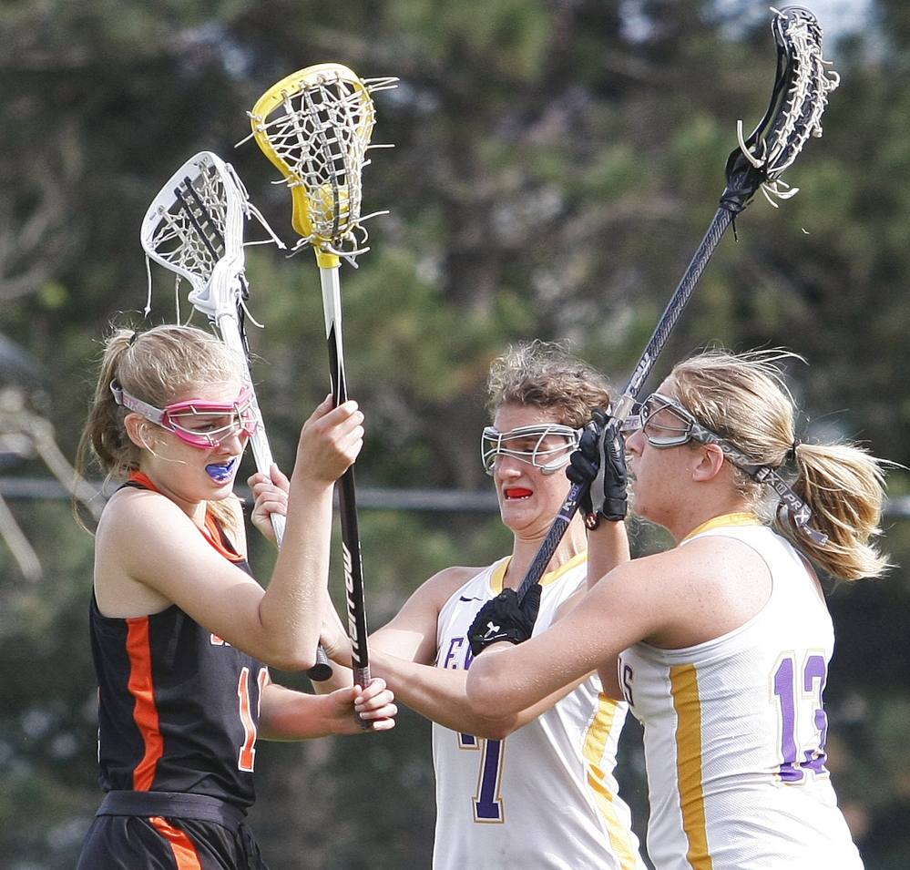 Brunswick's Sarah Ferdinand gets no open space with Cheverus defenders Elyse Caiazzo, center, and Alex Logan converging during an Eastern Class A girls' lacrosse quarterfinal game on Wednesday. Cheverus won 20-5 to advance to the semifinals.