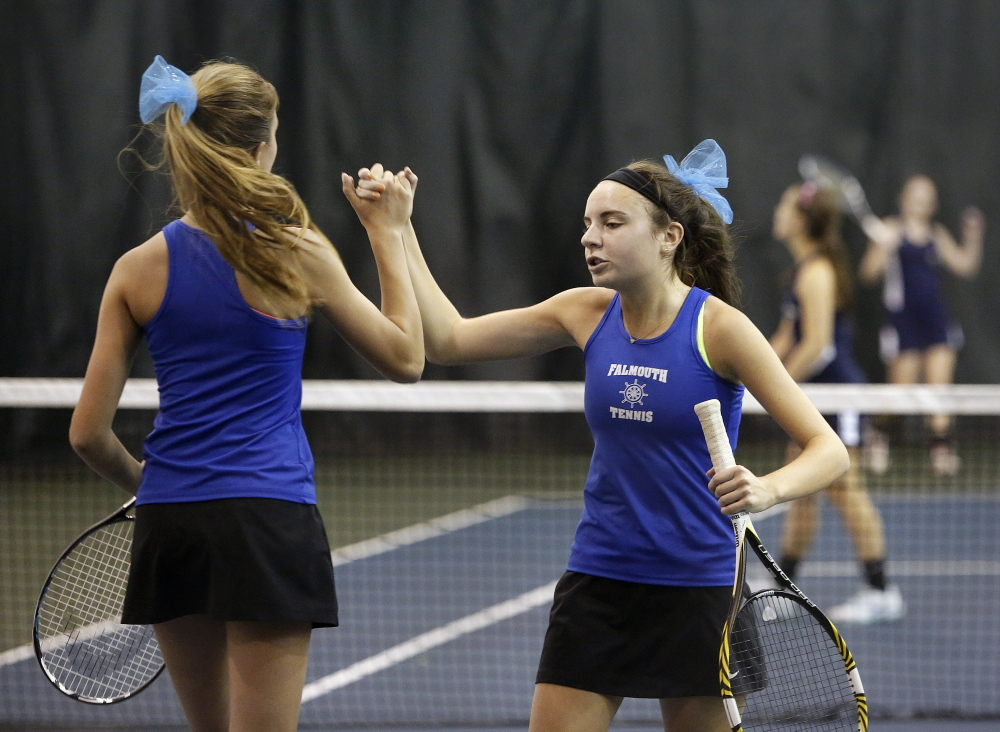 Kate Kelley, left, and Katie Ryan of Falmouth celebrate a point during the doubles match in the Class A Western tennis finals on Thursday. They won their match 6-3, 6-0.