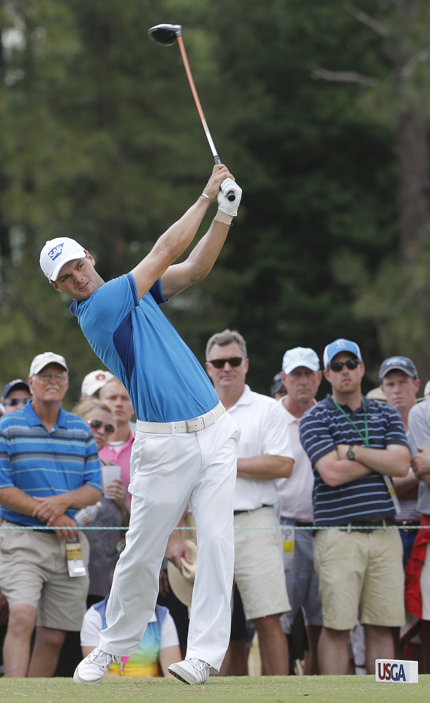 Martin Kaymer, of Germany, watches his tee shot on the eighth hole during the first round of the U.S. Open golf tournament in Pinehurst, N.C., Thursday, June 12, 2014.