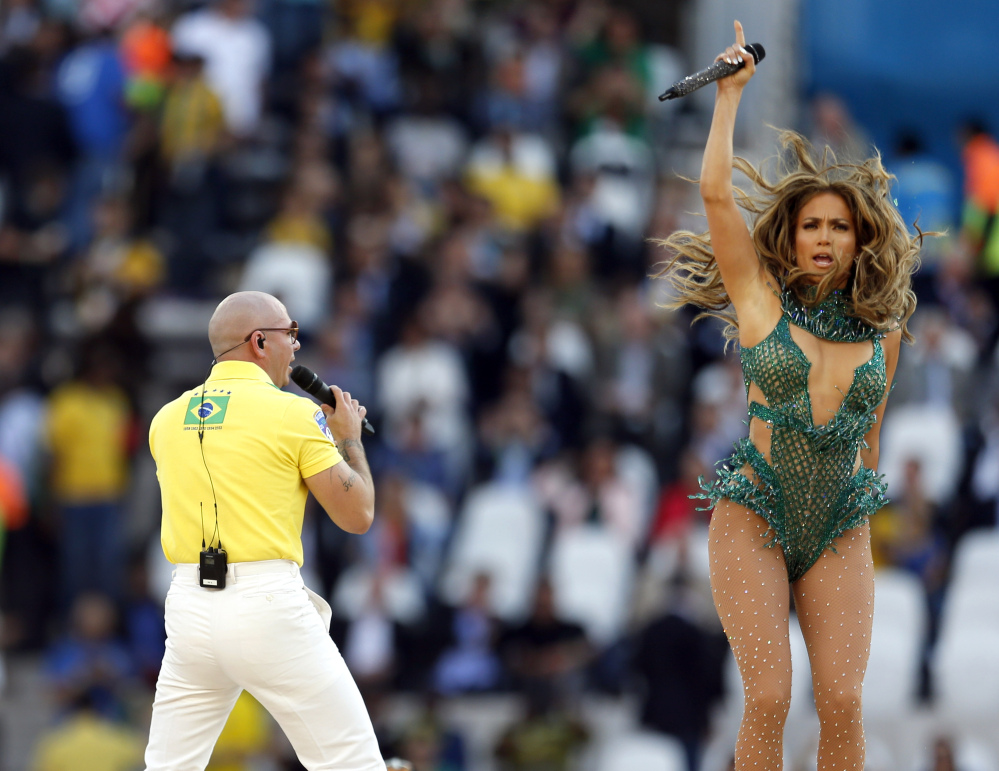 United States singer Jennifer Lopez, right, and rapper Pitbull, perform during the opening ceremony of the 2014 World Cup ahead of the group A soccer match between Brazil and Croatia, the opening match of the tournament, in the Itaquerao Stadium in Sao Paulo, Brazil, Thursday, June 12, 2014.