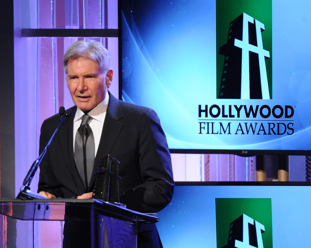 "Harrison Ford accepts the ""Hollywood Career Achievement Award"" onstage during the 17th Annual Hollywood Film Awards Gala at the Beverly Hilton Hotel in Beverly Hills, California, in 2013."
