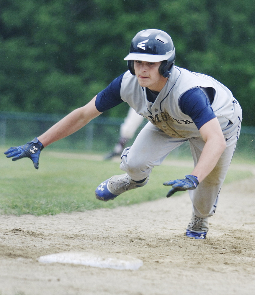 Cody Cook of 10th-seeded Yarmouth dives back to first base on a pickoff attempt Thursday in a 4-0 loss to second-seeded Greely in the Western Class B quarterfinal at Cumberland. Greely will be home against Poland in the semifinals.